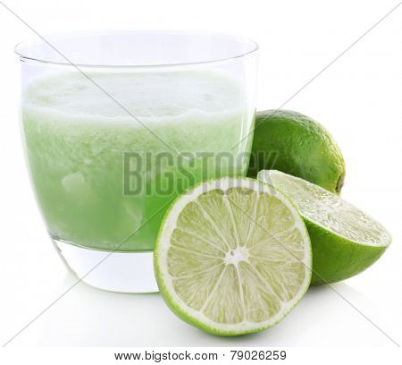 Glass of fresh lime juice with pieces of lime isolated on white