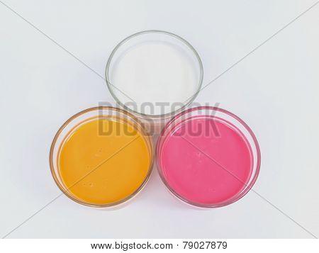 Strawberry Milk, White Milk And Tea Milk In Glass