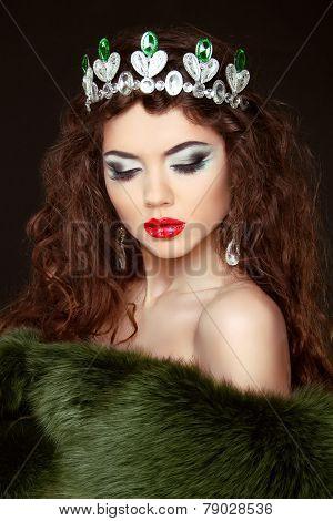 Beauty Fashion Model Girl In Fur Coat. Diamond Jewelry. Beautiful Luxury Winter Woman.