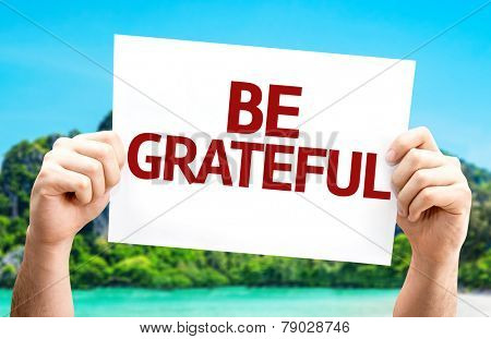 Be Grateful card with a beach on background