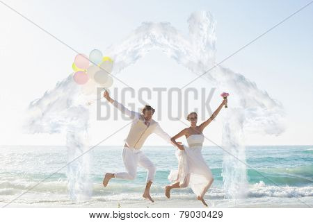House outline in clouds against newlyweds having fun holding balloons