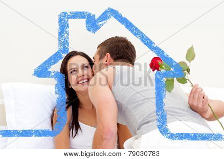 Husband giving a rose and a kiss to his beautiful wife against house outline