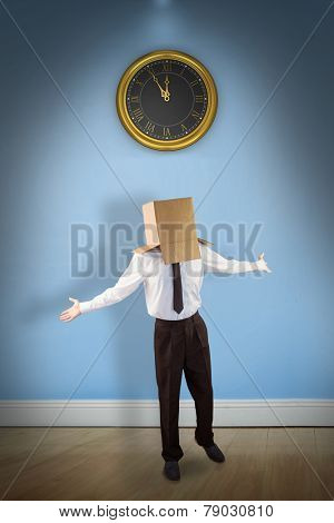 Anonymous businessman with arms out against blue room with wooden floor
