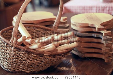 Group Of Cutting Boards And Wooden Rolling Pin In The Basket