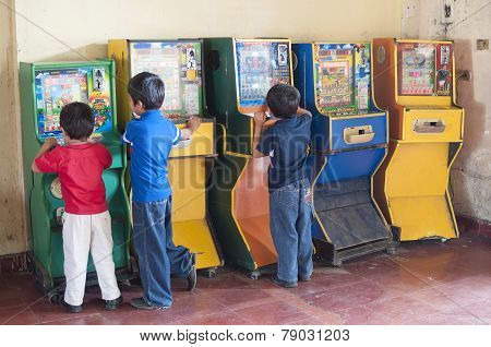 Children Playing Bingo Arcade Games