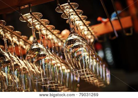 Many Empty Glasses For A Wine Hanging In A Bar