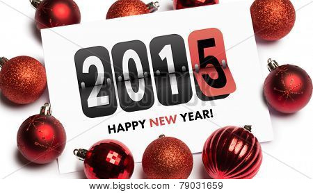 Happy new year 2015 against red christmas baubles surrounding white page