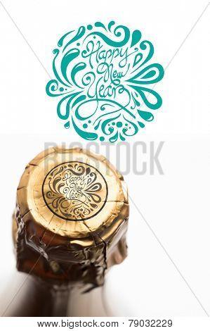 Elegant happy new year against foil on champagne bottle