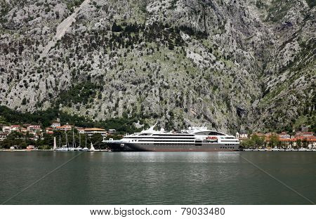 KOTOR, MONTENEGRO - JUNE, 08: Cruiser docked in the port of Kotor, on June 08, 2012, in Kotor, Montenegro
