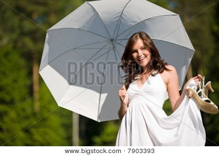 Happy Romantic Woman With Parasol In Sunglight
