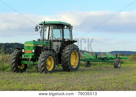 John Deere 2850 Utility Tractor And Small Trailer