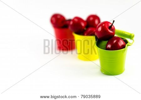 Buckets with apples