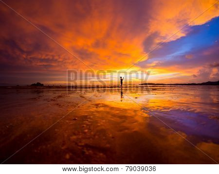 Woman photographer Sunset on the beach of Ao Nang in Krabi Thailand