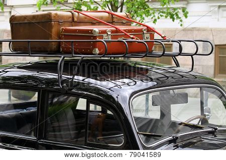 Vintage Suitcases On The Car Roof