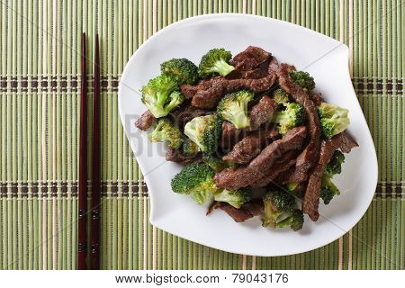 Beef With Broccoli And Chopsticks. Horizontal View From Above