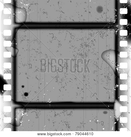 Grunge black and white frame and background with spoiled vintage film strip