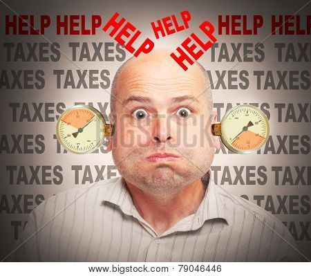 Frustrated and stressed businessman under pressure. High taxes concept.