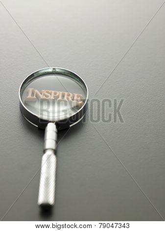 magnifying glass focus on alphabet dinspire