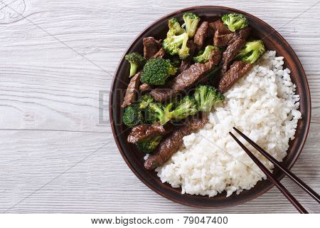 Beef With Broccoli And Rice On The Table. Horizontal Top View