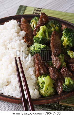 Asian Beef With Broccoli And Rice Close-up. Vertical