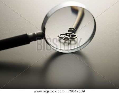 magnifying glass on a key