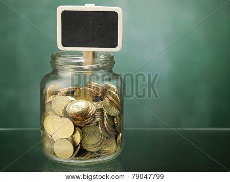 saving jar with the small black board