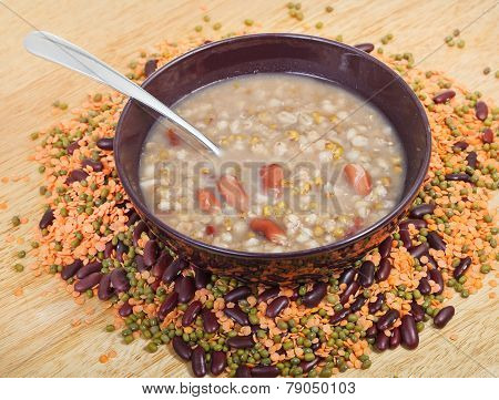 Mess Of Pottage In Bowl With Tablespoon On Plate
