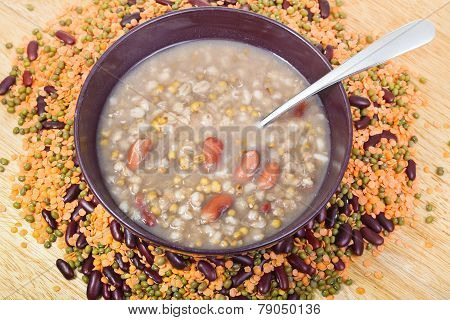 Top View Of Mess Of Pottage In Bowl With Tablespoon