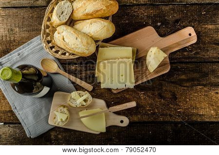 Delicious Ripe Cheese With Crispy Baguette And Wine