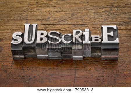 subscribe word in mixed vintage metal type printing blocks over grunge wood
