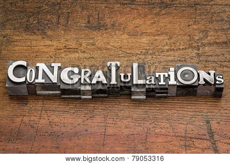 congratulations  word in mixed vintage metal type printing blocks over grunge wood