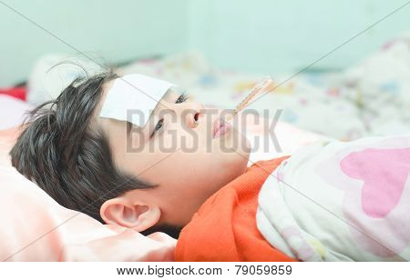 Little Sick Boy With Temperature In Mouth