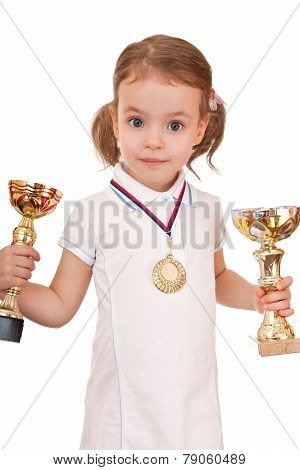 girl with a gold medal and cups.