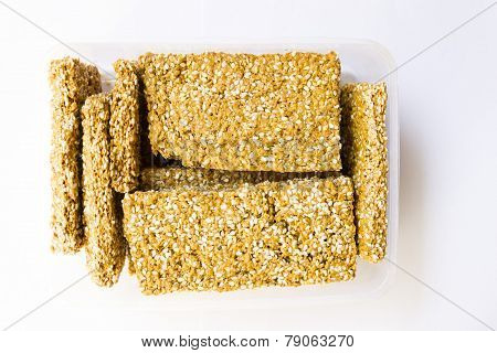sweet savoury made from jaggery paste and sesame seeds