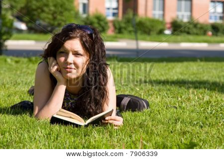 Student Studying On The Grass