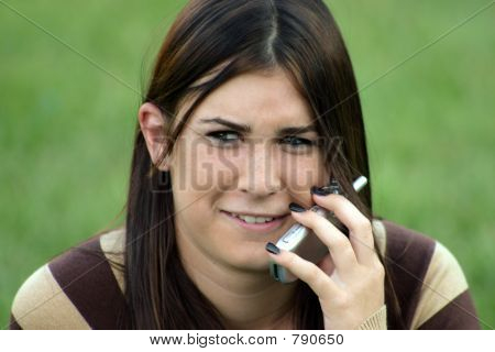 Girl Making Face on Cell