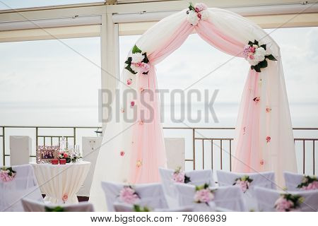 Pink Wedding Arch With Flowers