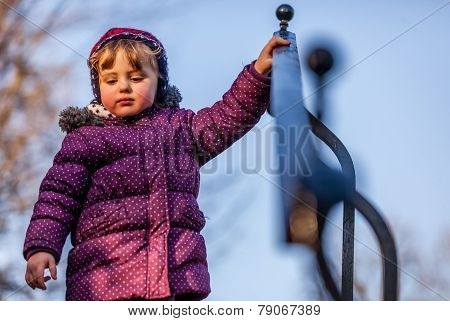 Girl holding on to railing