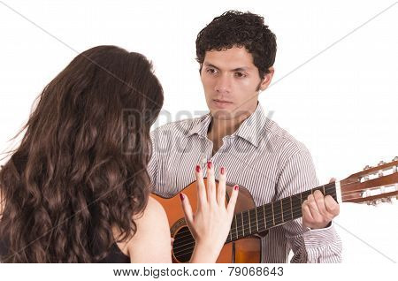 handsome man with guitar serenading young girl
