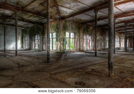 Old Abandoned Hall With Rails