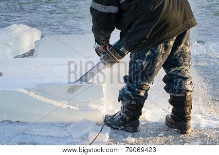 Man Handles The Ice Chainsaw