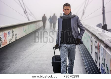Trendy Handsome Man Walking With A Suitcase