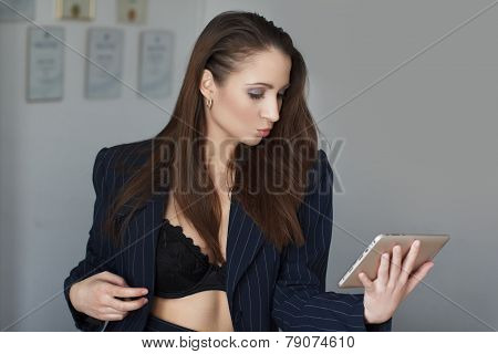 Businesswoman Sending Kisses By Tablet