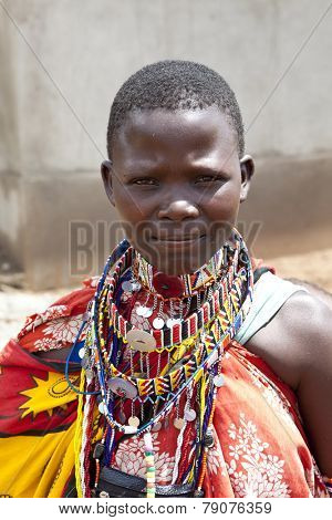 BISIL, KENYA-DECEMBER 7 2010: Unidentified Maasai woman in traditional clothing and jewelry near the village of Bisil in Southern Kenya