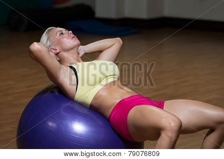 Young Woman Doing Abs Workout