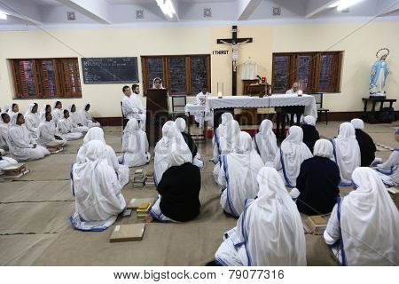 KOLKATA, INDIA - FEBRUARY 15: Sisters of The Missionaries of Charity of Mother Teresa at Mass in the chapel of the Mother House, Kolkata, India at February 15, 2014.