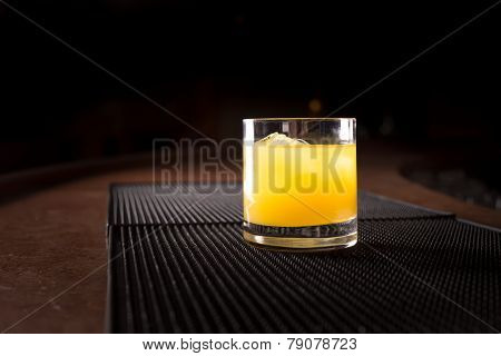 Screw Driver Cocktail On A Bar Ribber Mat