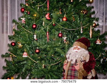 Santa Doll Under Christmas Tree