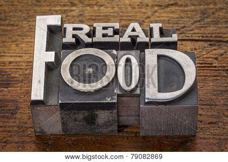 real food in mixed vintage metal type printing blocks over grunge wood