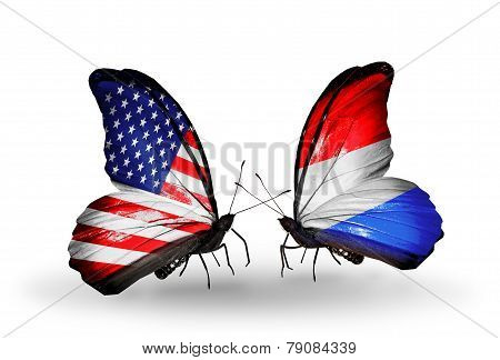 Two Butterflies With Flags On Wings As Symbol Of Relations Usa And Luxembourg